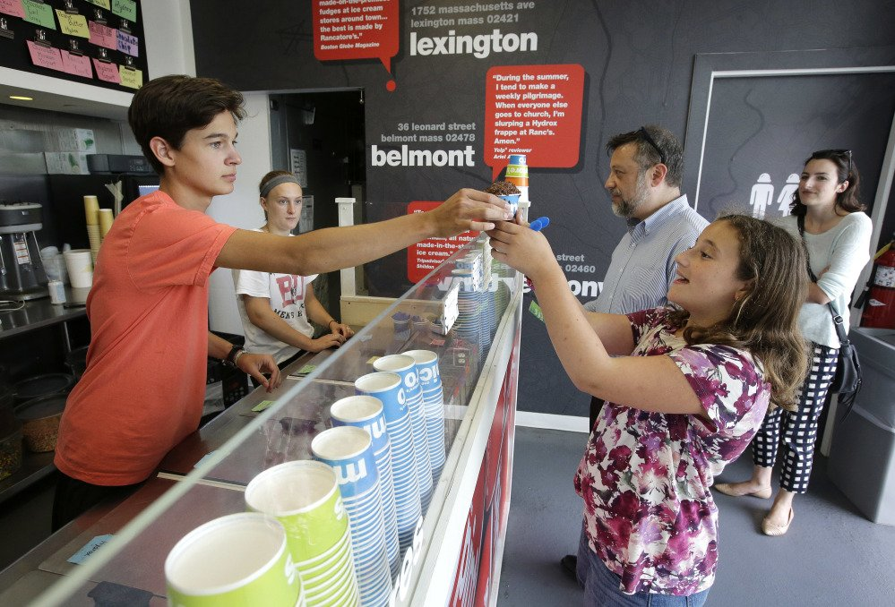 Nick Tzannes serves ice cream to Magnolia Keller-Deutsch on Tuesday at Rancatore's Ice Cream & Yogurt, a pop-up in Newton, Mass. Entrepreneurs and cities are increasingly embracing the pop-up concept.