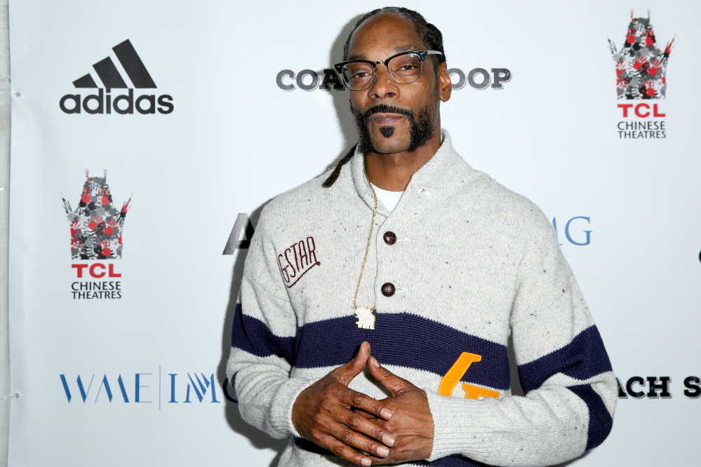 Authorities say 42 people were hurt when a railing collapsed during an outdoor concert by Snoop Dogg, above, and Wiz Khalifa in southern New Jersey.  AP file photo