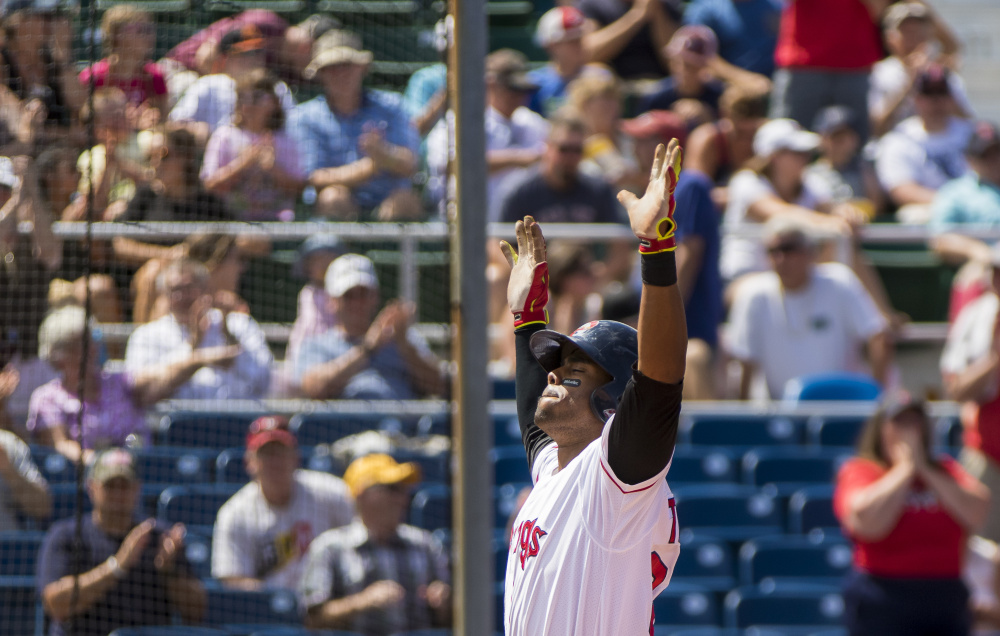 Aneury Tavarez celebrates after rounding the bases following his second home run Sunday against the Akron RubberDucks. Tavarez raised his Eastern League-leading average to .330 while helping the Sea Dogs to a 5-3 win.