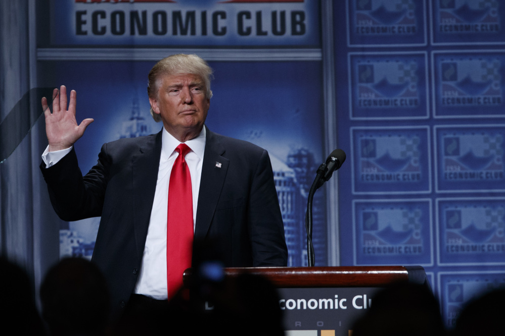 Republican presidential candidate Donald Trump waves after delivering an economic policy speech to the Detroit Economic Club on Monday in Detroit.  Among the inaccuracies in the speech: He wrongly accused Hillary Clinton of proposing to increase middle-class taxes.