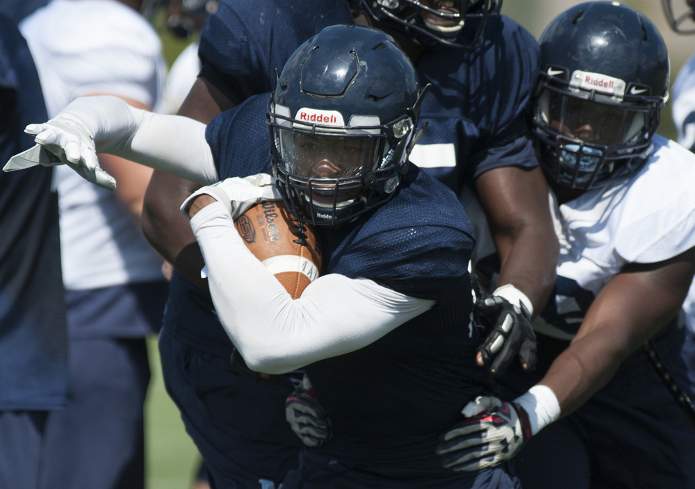 """Zaire WIlliams, seen at Monday's practice in Orono, says, """"As a team, we want 200 (rushing) yards a game."""""""