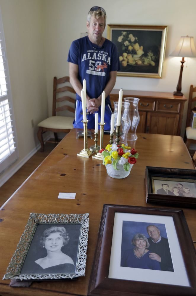 "Steve Knowlton talks about his mother Mary Knowlton, shown in family photos, during an interview Wednesday, Aug. 10, 2016, in Punta Gorda, Fla. Police say an officer accidentally shot Mary to death during a citizen's academy ""shoot/don't shoot"" exercise Tuesday evening. (AP)"