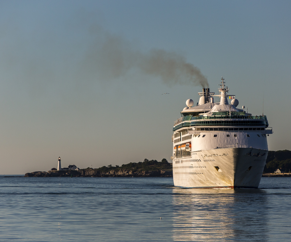Smoke billows from the stack as the cruise ship Grandeur of the Seas enters Portland Harbor earlier this month with 1,950 passengers.