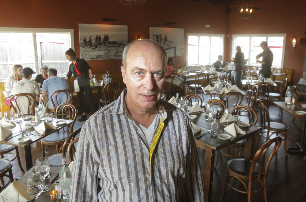 Sante Calandri, who owns Ports of Italy restaurants in Boothbay and Kennebunk, says that finding workers this summer has been challenging.