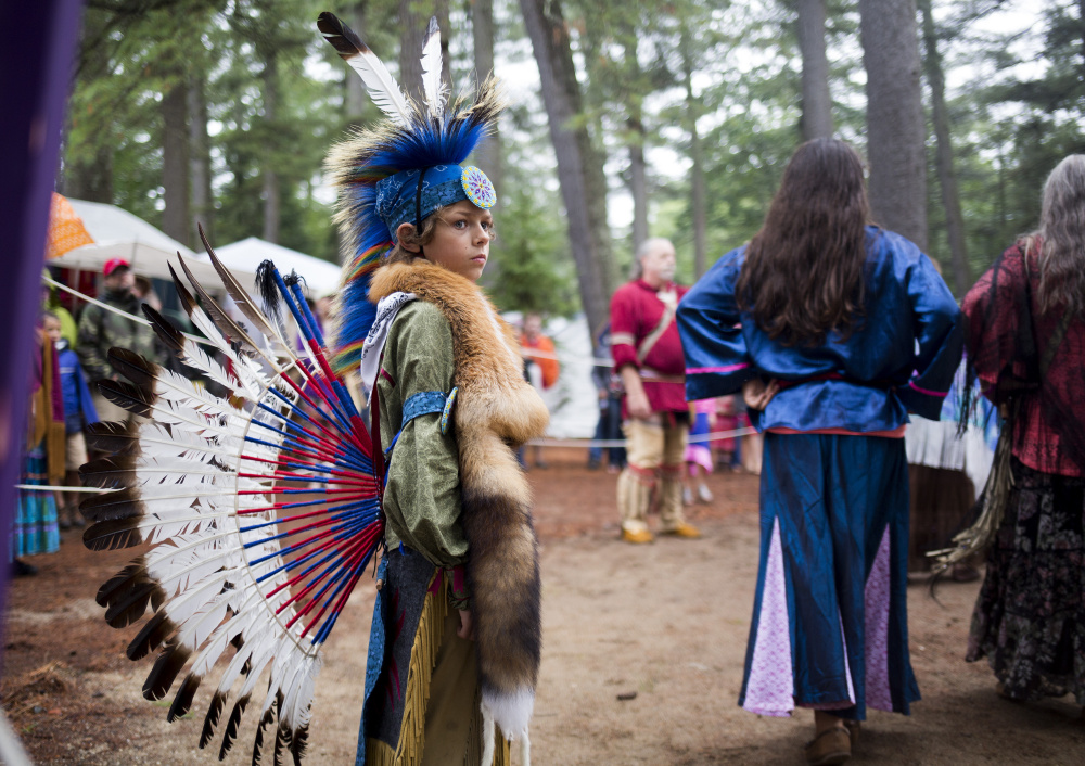 Robert Allen, 10, stands guard during the women's traditional dance at the Attean Family Pow Wow at Maine Wildlife Park on Saturday, August 13, 2016.