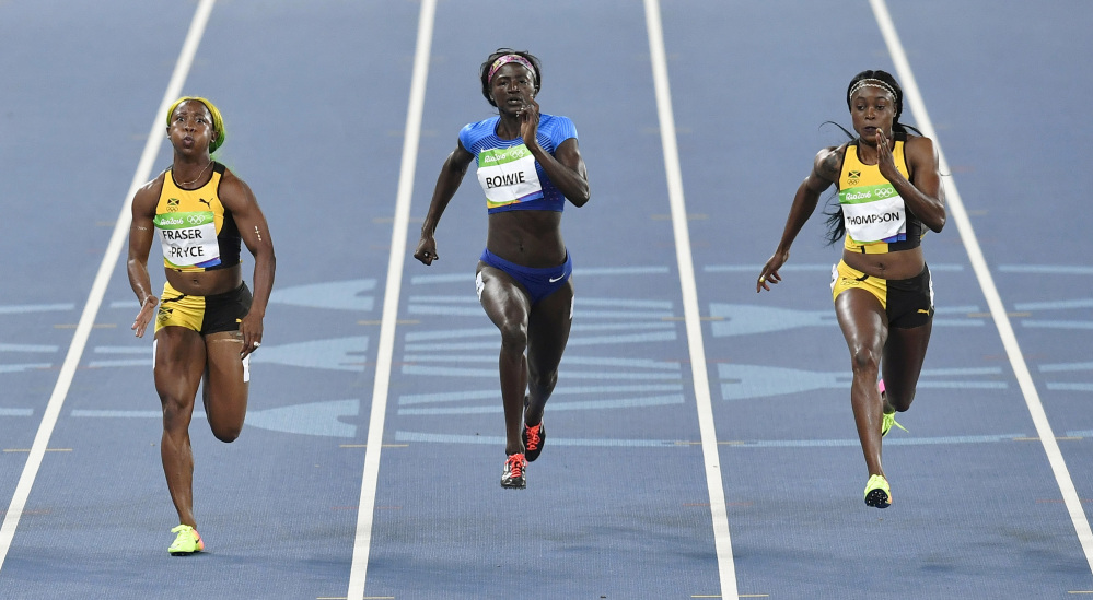 Jamaica's Elaine Thompson, right, United States' Tori Bowie, center, and Jamaica's Shelly-Ann Fraser-Pryce compete in the women's 100-meter final during the 2016 Summer Olympics in Rio de Janeiro, Brazil, on Saturday.