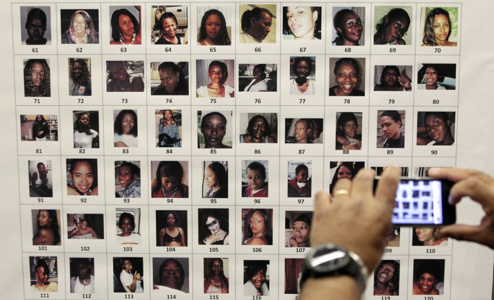 Photographs found in the home of Lonnie Franklin Jr. are shown at a police news conference in Los Angeles.