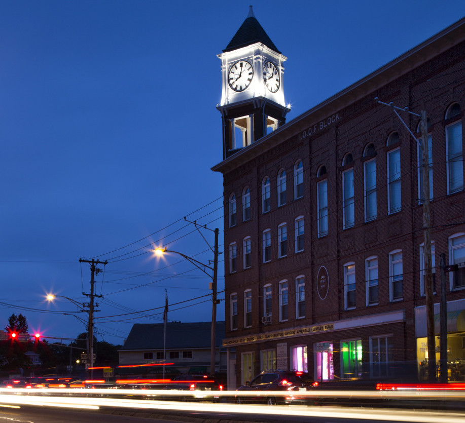 The restored clock tower at Woodfords Corner in Portland is keeping time again for the first time in nearly two decades. Some hope the restoration will set the tone for the corner's rebirth.