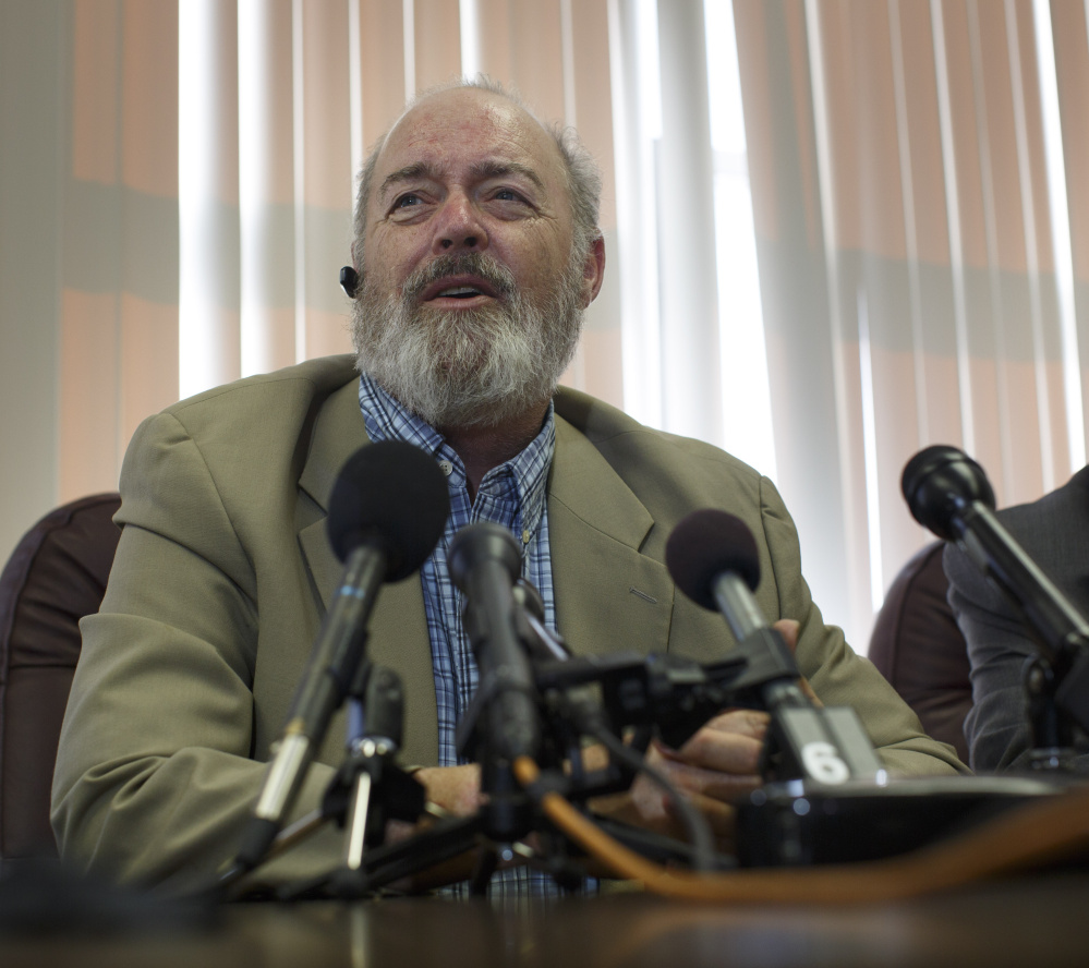 Attorney Mitchell Garabedian holds a news conference Monday to announce a $1.2 million settlement with the Diocese of Portland for six sex abuse victims of the Rev. James Vallely. Victim Lawrence Gray, left, who was abused beginning in 1958, also spoke during the news conference.