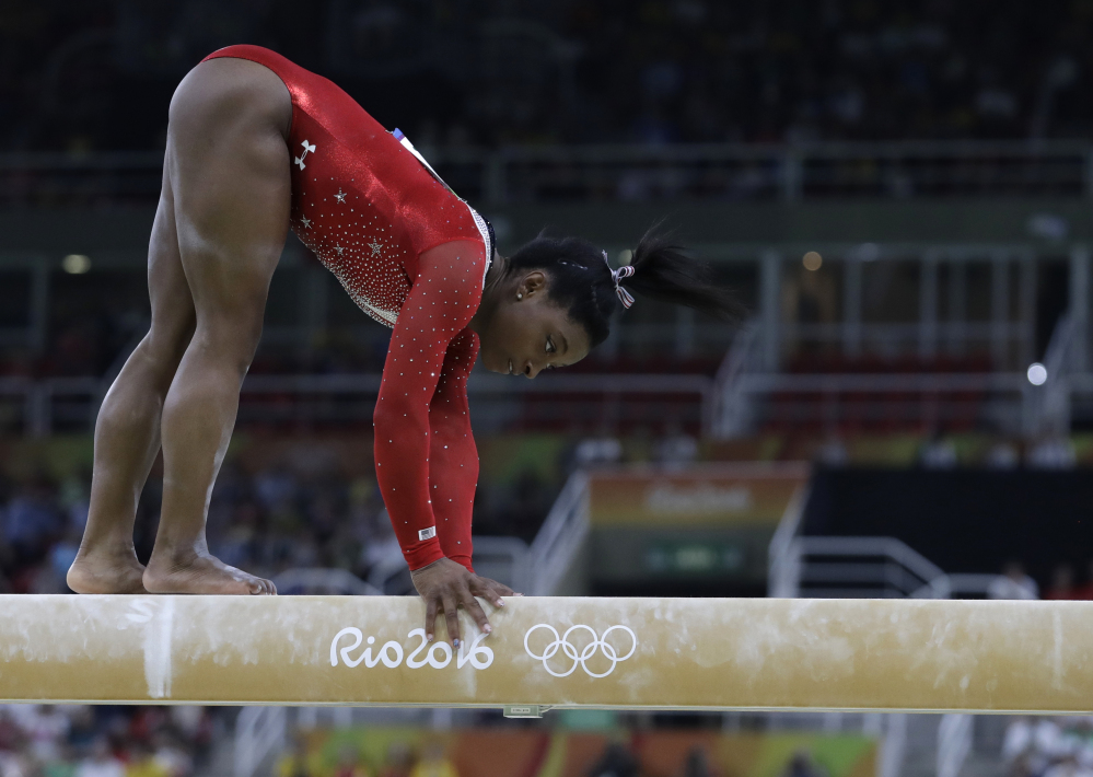 Simone Biles of the U.S. stumbles during her balance beam routine during the artistic gymnastics women's apparatus final at the 2016 Summer Olympics in Rio.