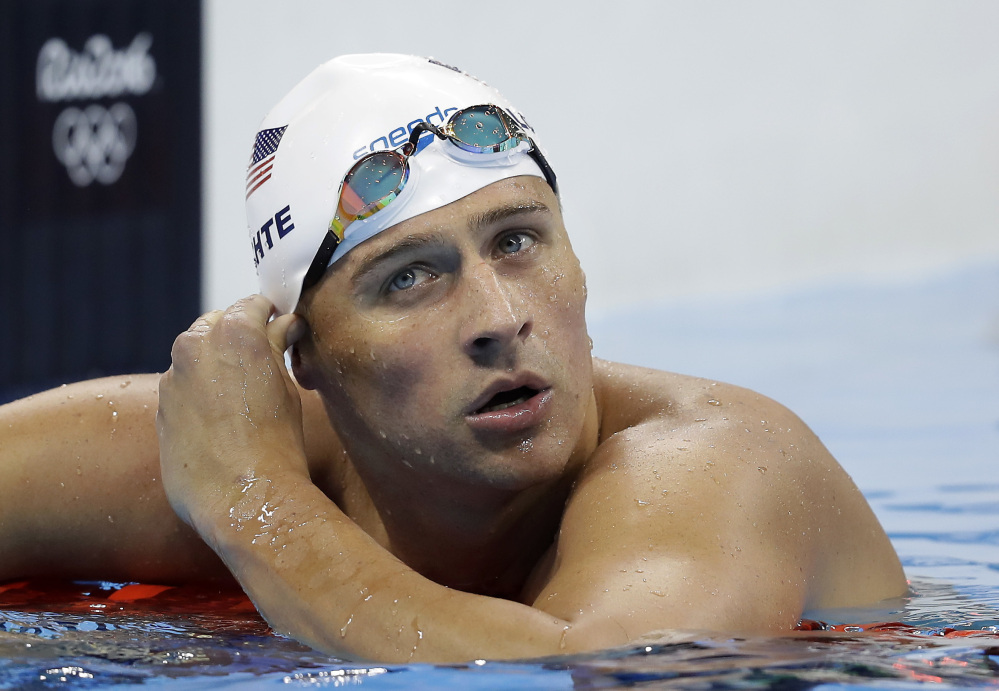 United States' Ryan Lochte checks his time in a men's 4x200-meter freestyle heat during the Summer Olympics, in Rio de Janeiro, Brazil, last week. Lochte and three other American swimmers reported being robbed at gunpoint early Sunday.
