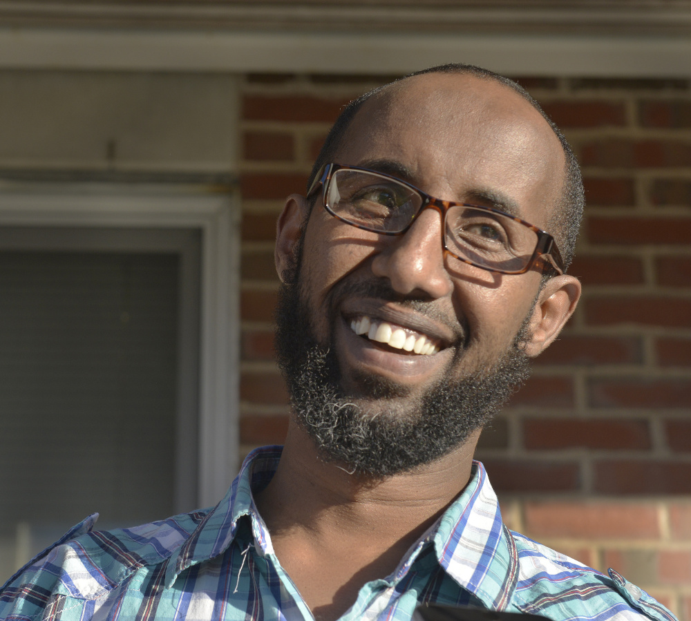 """Mahmoud Hassan of Portland, president of the Somali Community Center, said he attended Thursday's meeting in Westbrook to show his support. """"We must stand against racism and hatred,"""" he said."""