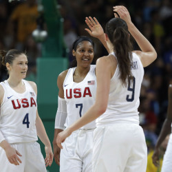 Lindsay Whalen, left, and Maya Moore celebrate with teammate Breanna Stewart, right, during the U.S. women's basketball team's 101-72 win over Spain in the gold medal game Saturday in  in Rio de Janeiro, Brazil.