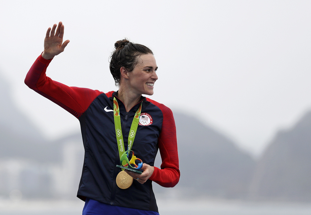Gwen Jorgensen, of the United States, waves after receiving the gold medal for winning the women's triathlon event on Copacabana beach at the 2016 Summer Olympics in Rio de Janeiro, Brazil, on Saturday.