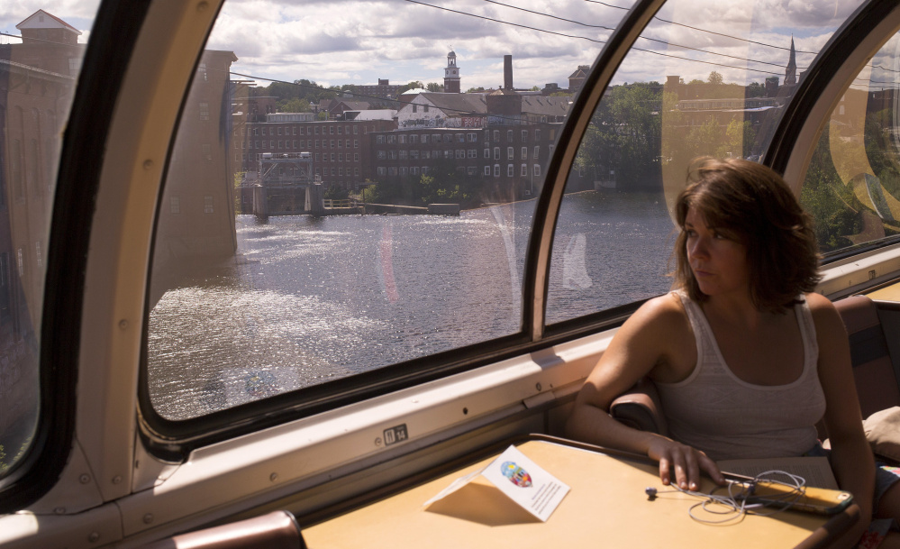 """Kerstin Egenhofer rides in an original 1955 dome observation car while traveling from Boston on the Downeaster to spend a day off of work in the Portland area. """"I wanted to make an experience out of my trip,"""" Egenhofer said. """"This put the bow on it."""""""
