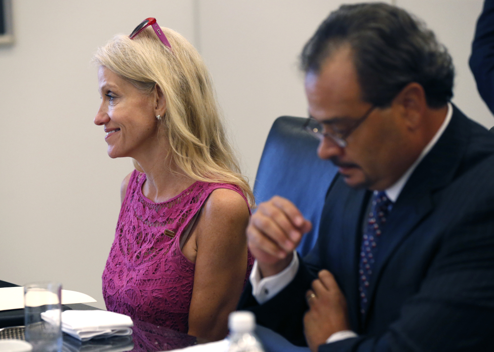 Kellyanne Conway, left, campaign manager for Republican presidential candidate Donald Trump, attends his Hispanic advisory roundtable meeting in New York, Saturday, Aug. 20, 2016. At right is Rick Figueroa, first vice president for FINC Firm of Houston. (AP Photo/Gerald Herbert)