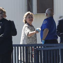 Democratic presidential candidate Hillary Clinton greets people as she arrives at Provincetown Municipal Airport in Provincetown, Mass., Sunday.