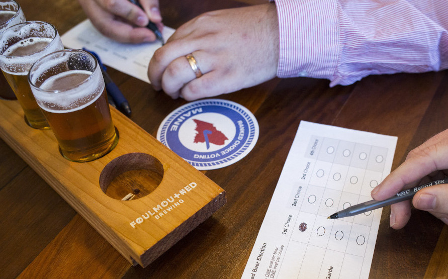 Finn Melanson, a volunteer with the League of Women Voters, ranks his beer choices in a demonstration at Foulmouthed Brewing in South Portland.