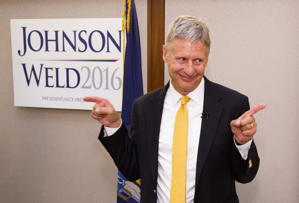Former New Mexico governor and Libertarian presidential candidate Gary Johnson acknowledges supporters after his campaign speech at the Portland Regency on Friday.