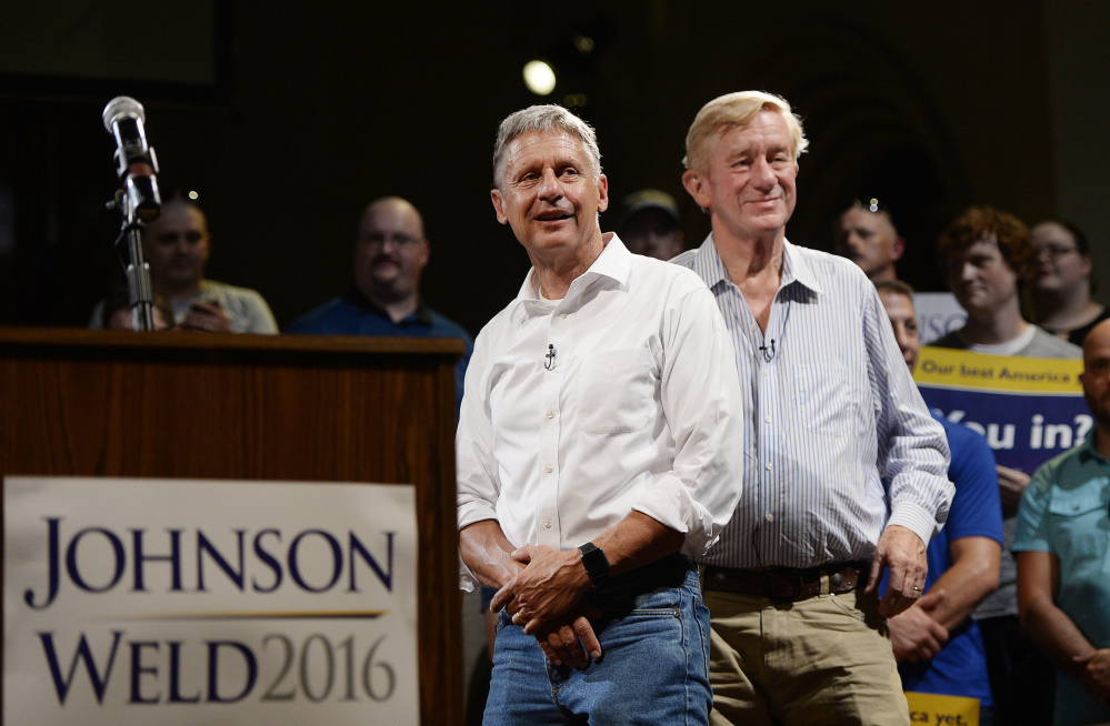 Gary Johnson, left, campaigning Friday in Lewiston with running mate Bill Weld, said his humility, desire to serve the public and willingness to work with people at both ends of the political spectrum distinguish him from Donald Trump and Hillary Clinton. Shawn Patrick Ouellette/Staff Photographer