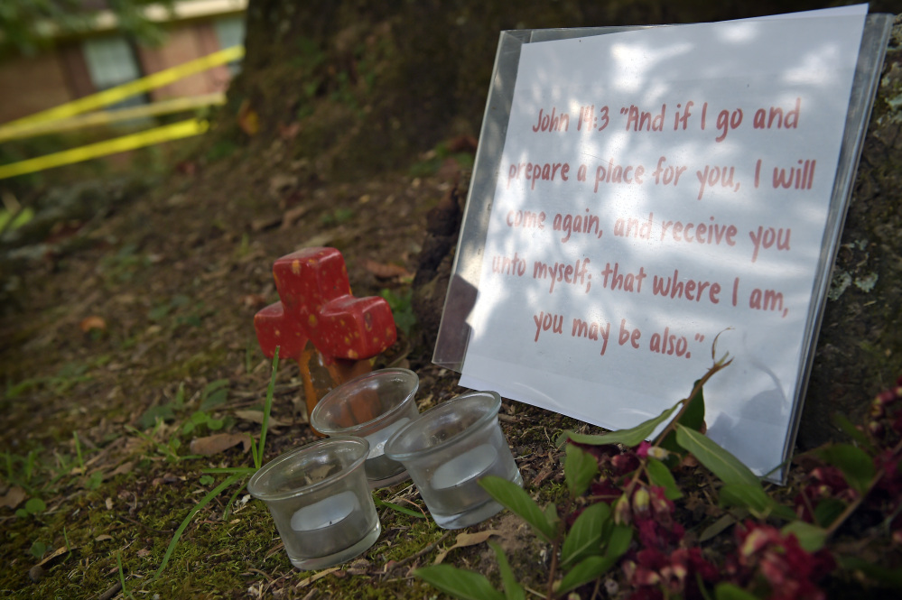 A memorial is placed outside the crime scene tape at the home in Durant, Miss., where Sister Margaret Held and Sister Paula Merrill were found slain Thursday morning.