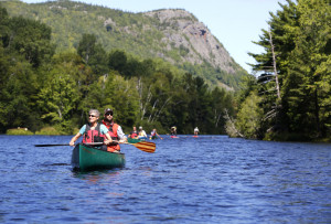 U.S. Secretary of the Interior Sally Jewell shares a canoe with Lucas St. Clair, president of Elliotsville Plantation Inc., on an 8-mile paddle down the East Branch of the Penobscot River on Saturday. Jewell will speak Sunday at a ceremony in Millinocket for the newly designated Katahdin Woods and Waters National Monument.