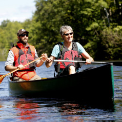 U.S. Secretary of the Interior Sally Jewell paddles the East Branch of the Penobscot River on Saturday with Lucas St. Clair, son of philanthropist Roxanne Quimby.