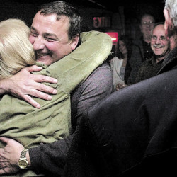 Paul LePage gets a hug from a supporter in November 2003 after he was elected mayor of Waterville. LePage served until 2010, when he was elected Maine governor.