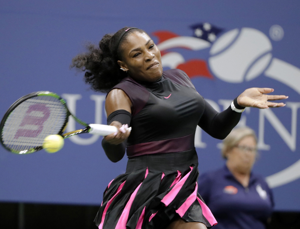 Serena Williams returns a shot from Ekaterina Makarova during a first-round win at the U.S. Open on Tuesday in New York. Williams is after a record-breaking 23rd major title.