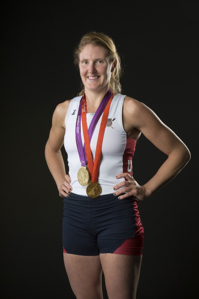 Ellie Logan wears her Olympic gold medals.