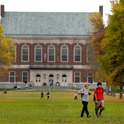 Students walk on the mall at the University of Maine in Orono, the flagship campus of the state university system.