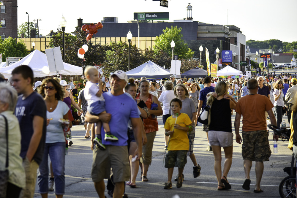Attendees stroll about downtown Wednesday evening during the Taste of Waterville.