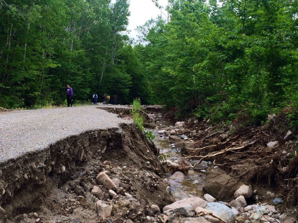 Heavy damage to No Road, a gravel road that provides access for about 30 property owners in the unorganized territory of Somerset County, attracted several spectators who were surveying the damage July 2.