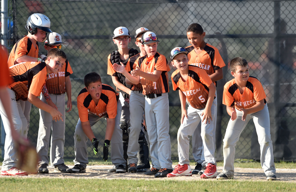 Skowhegan teammates wait at home plate to celebrate Simon Lewis' home run against Marlboro, Massachusetts in the 11U Cal Ripken New England tournament Wednesday at the Carl Wright Complex in Skowhegan.