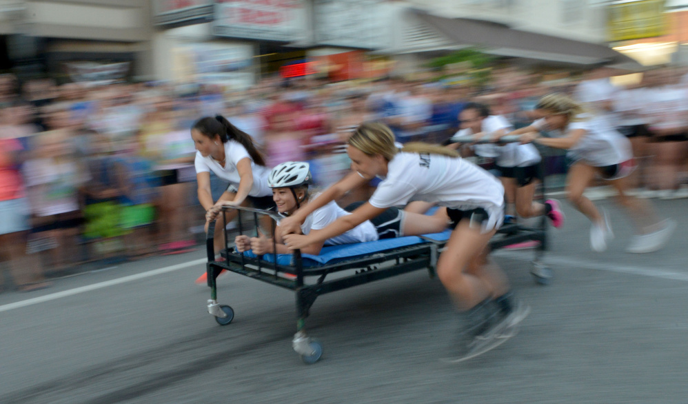 A bed race team competes in the annual bed races Thursday at Moonlight Madness in downtown Skowhegan.