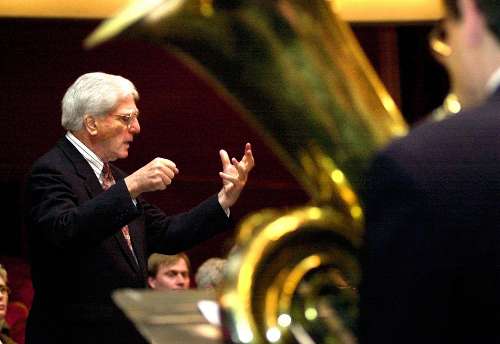 "Peter Ré conducts an orchestra through ""Fanfare for the Waterville Bicentennial,"" which he composed for the city's 200th celebration in 2002. Ré, who died July 24 at 97, is remembered for the legacy of music he left at Colby College, where he taught for many decades."