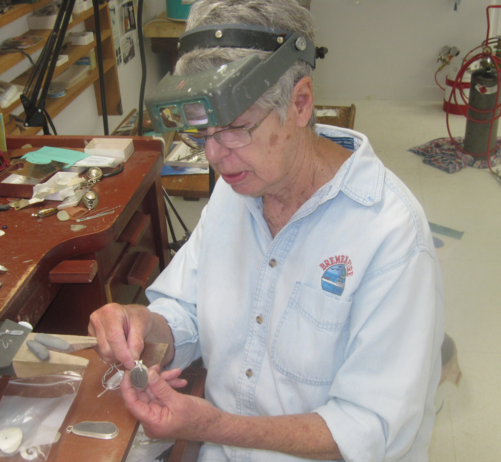 Contributed photo Mary Hall works on jewelry in her workshop.