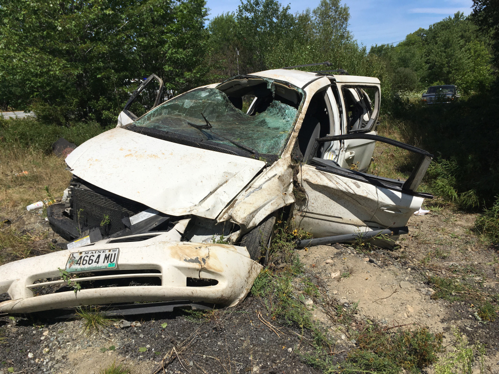 A 2005 Dodge Caravan driven by Shanya Pottle, 20, of South China, stands by the side of U.S. Route 201 in Madison after a one-vehicle crash Tuesday morning. Pottle was seriously injured and the yellow Labrador retriever puppy that was in the van fled the scene and is still missing.