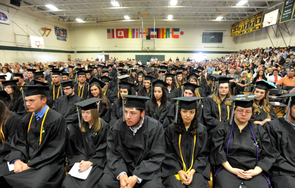 The Unity College class of 2015 listens during the school's commencement ceremony in May. School officials said Thursday they expect about 700 students to be enrolled when the college opens for the years Aug. 29, the largest student body ever.