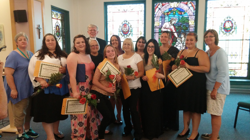Ten local area students graduated as certified nursing aides on Aug. 3 from Mount Saint Joseph's Residence and Rehabilitation facility in Waterville. Front, from left, are Tammy Thayer, R.N.; Kellie Bourgon, Atisha Morse, Anita Dunham, Skowhegan CareerCenter manager; Collen Brewer, Diane Hatch, Halie Michaud, Deborah Rowe-Warger, and Diane Sinclair, R.N., Mount Saint Joseph's administrator. Back, from left, are Bill Laney, RSU 54 Community & Adult Education director; Ashlynn Libby, Melissa Lawler and Cherelle Pomeroy. Laura Moshier unavailable for photo.