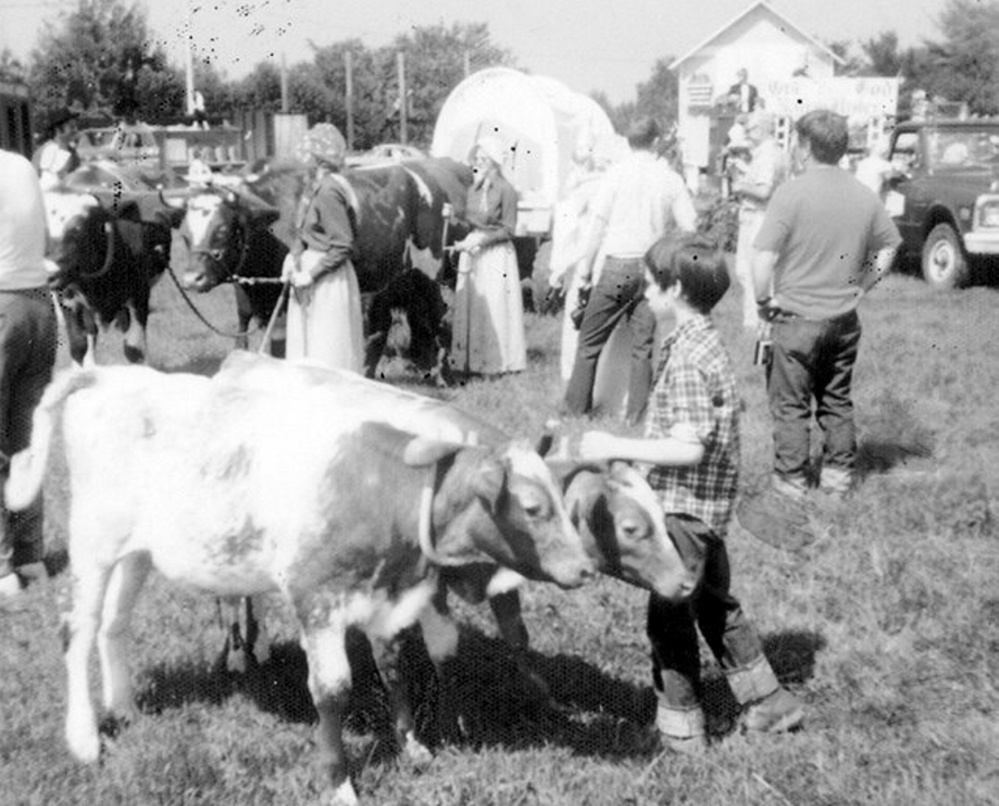Peter Monti, front and center, of Jefferson, had this pair of young steers in the 1976 July 4th parade in the United States Bicentennial year. In the background are pioneers Claudia and Claudene Orff with their oxen hauling a pioneer wagon. This photo is one of many on display at the Jefferson Historical Society's open houses planned for Aug. 17 and 24. Also available will be the 2017 Jefferson Historical Photo Calendar.