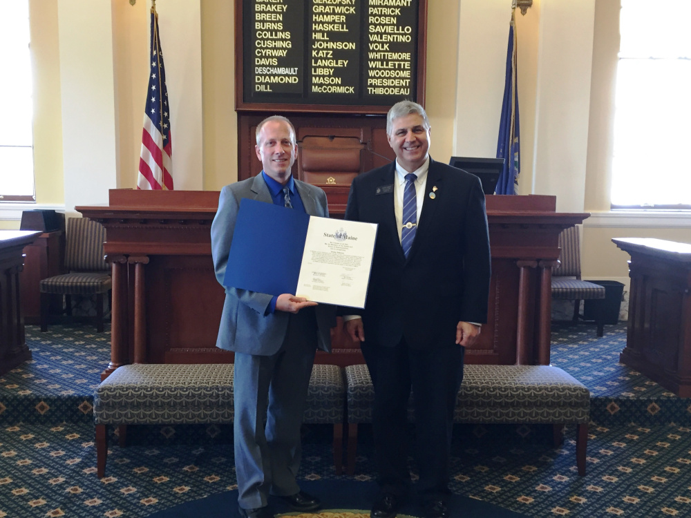 Sen. Scott Cyrway, R-Benton, right, presented a legislative sentiment July 15 to Craig Johnson, left, of Benton, honoring Johnson's retirement after 28 years in law enforcement. Johnson most recently served as the Chief of Police for the Clinton Police Department for six years. He began his career with the Somerset County Sheriff's Department and has also worked for the police departments of Damariscotta and Newport.