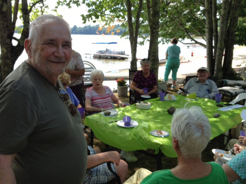 George Fowler, left, attends a picnic Aug. 6 at Unity Pond in Burnham for the widows-and-widowers' group he formed about 10 years ago.