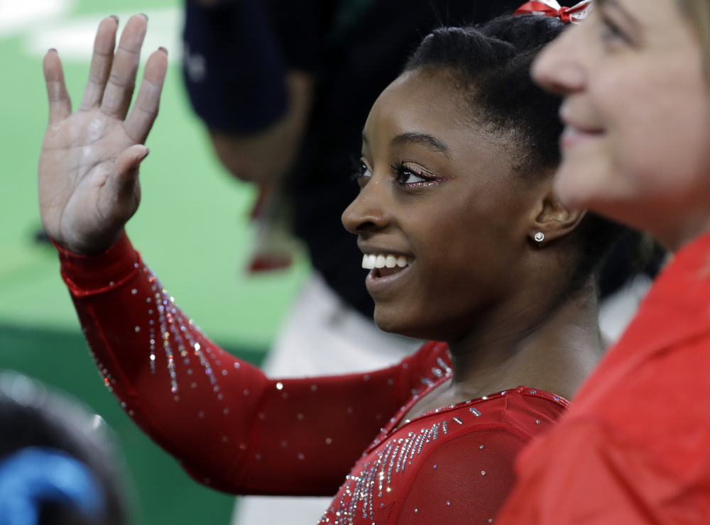 United States' Simone Biles waves to the audience after performing on the vault during the artistic gymnastics women's apparatus final Sunday at the 2016 Summer Olympics in Rio de Janeiro.