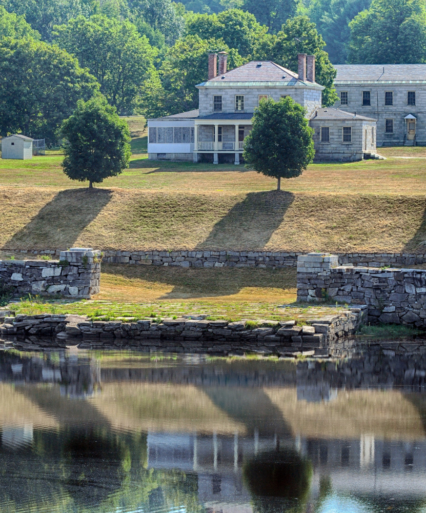 The hillside leading down to granite dock below the Kennebec Arsenal in Augusta shows evidence of recent mowing Friday.