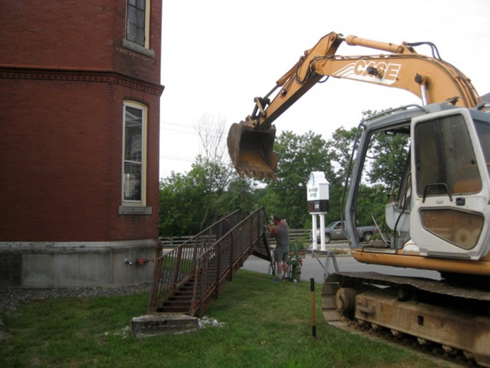 The old fire escape at the Skowhegan Free Public Library comes down to make way for construction of the elevator addition.