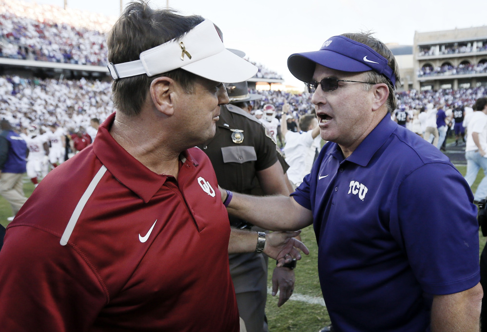AP photo   In this Oct. 4, 2014, file photo, Oklahoma head coach Bob Stoops, left, and TCU head coach Gary Patterson meet after a game at Amon G. Carter Stadium in Fort Worth, Texas.