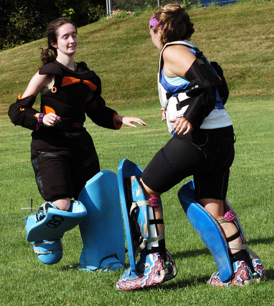 Messalonskee field hockey goalies Hannah Pinney, left, and Julie Vigue go through drills during practice last season.