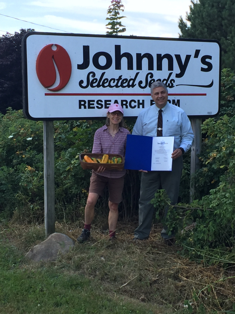 The owners and staff of Johnny's Selected Seeds in Winslow were presented a Legislative Sentiment on Aug. 3 by Sen. Scott Cyrway, R-Benton. The sentiment honored the business for having two of its pepper varieties selected as 2016 AAS Vegetable Award Winners. From left, are Janika Eckert, co-owner of Johnny's Selected Seeds, and Cryway.