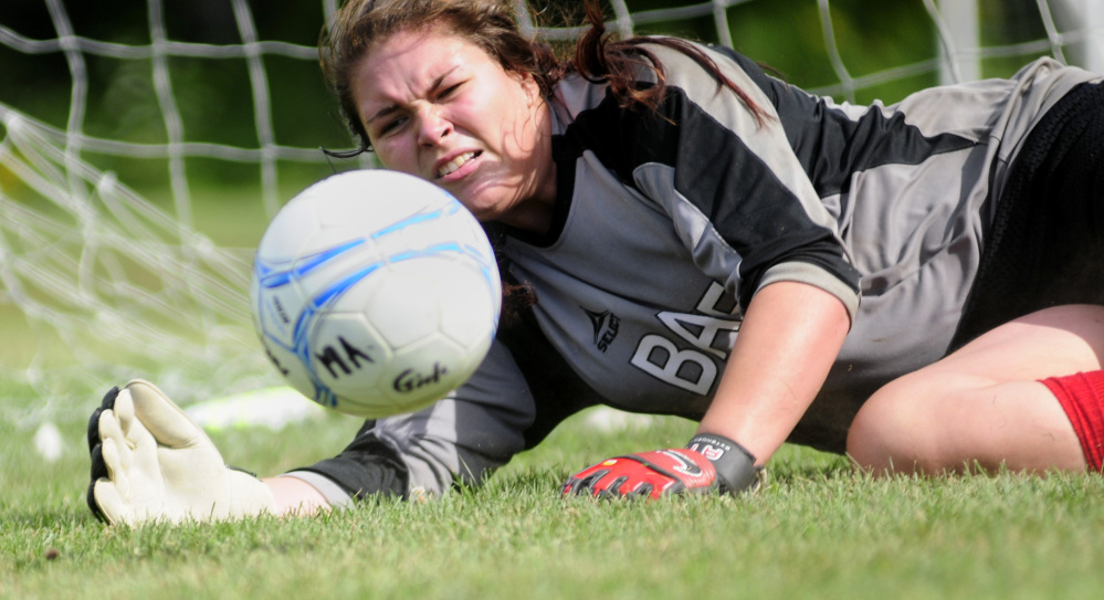 Monmouth Academy girls goalie Destiny Clough makes a save during practice Tuesday at Monmouth Academy in Monmouth.